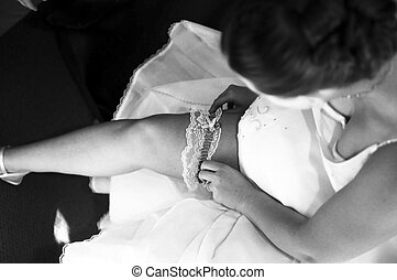 Bride and garter - Bride putting garter onto leg
