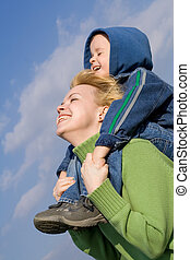 Mother and son having fun outdoors in springtime