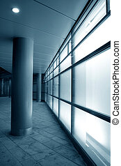 White glass facade - Glowing glass in modern building facade...