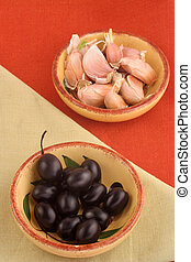 olives and garlic - two dishes with black olives and garlic