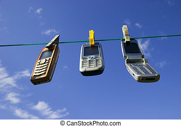 Network of wireless devices - Three Cell Phones Drying on...