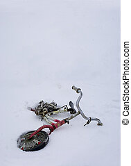 Abandoned bicycle in snow Concept of gone lost childhood