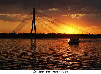 Cable bridge in sunset - Riga suspension bridge\\\'s...