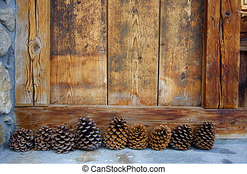 decoratives pine cones with wooden background