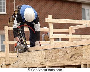 Carpenter framing a new home.