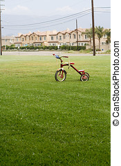 Child\\\'s bicycle On Green Lawn