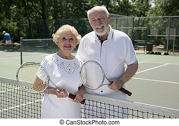 Active Senior Tennis Players - An attractive senior couple...