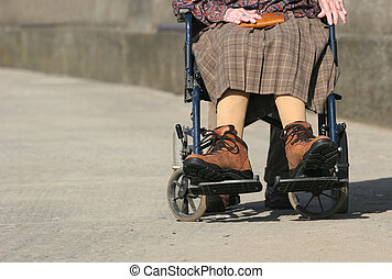 Wheelchair Bound - Lower body of a an elderly woman sitting...
