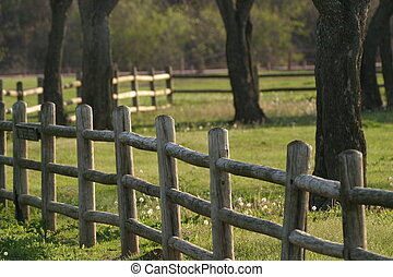 Wooden fence near a pasture