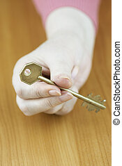 key to success - selective focus on key and hand, special...