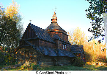 Ancient rural church in the autumn landscape
