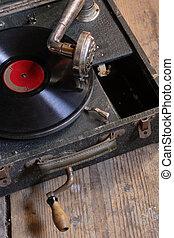 Old turntable - An antique box record player with crank,...
