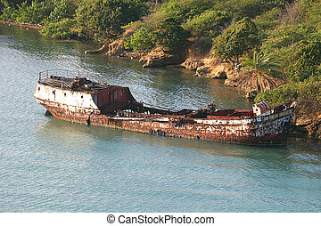 Rusted Hulk - Old rusted skeleton of a ship in the wter
