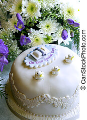 Christening cake - A christening cake in front of a flower...