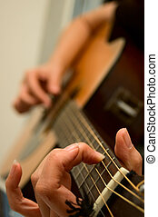 Guitar Player - Young woman playing guitar - shallow depth...