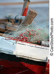 Red dhow sailing boat with nets, qaurter view, close-up of...