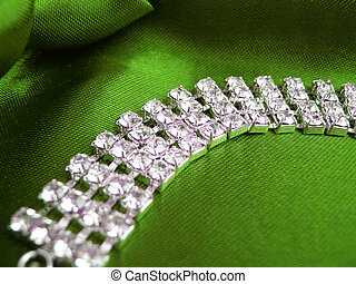dimond necklace - Close up of dimond necklace on green...