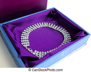 dimond necklace - Close up of dimond necklace on a blue box...