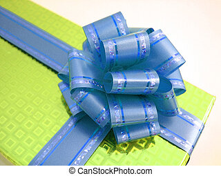 yellow box - blue ribbon tied in a yellow box over a white...