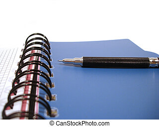 blue notebook with black pencil