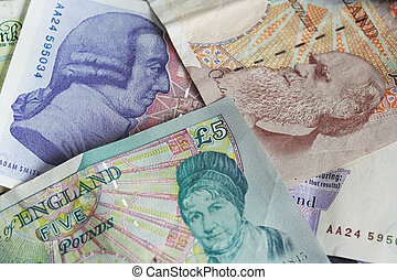 Backs of GBP notes - The backs of GBP notes showing the...
