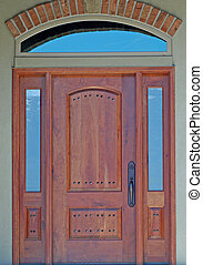 Front Door - Wooden front entry door with side windows.