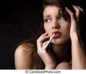 sexy woman with cigarette - beautiful brunette wearing black...