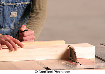 Cutting - A female woodworker cross cuts apiece of pine