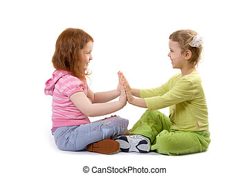 Two little girls play, isolate over white