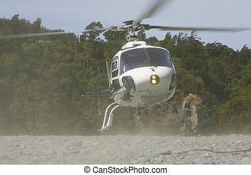 Dusty Landing - A helicopter comes in to land on a dusty dry...