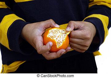 Healthy eating - Eating an orange is healthy eating habit