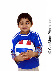 Kid with Volleyball - A young handsome kid holding a...