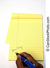 Writing a letter - A yellow notepad and a pen isolated...