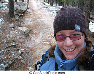 Hiking Self-Portrait - Hiking along a trail in the Rocky...