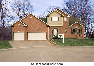 House For Sale - a brick house with a for sale sign