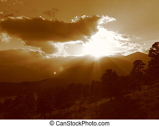 Rocky Mountain Sunset II - The sun setting behind the...