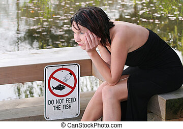 Plenty Of Fish - A young woman waits for the next fish to...