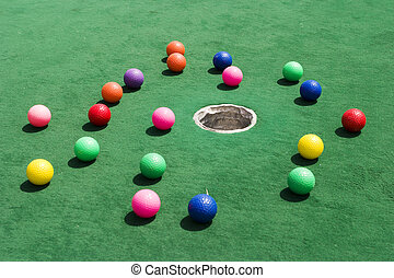 Scattered Golf Balls - A number of brightly colored golf...