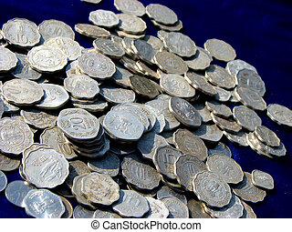 Lots of Coins - Many Indian coins on a blue satin