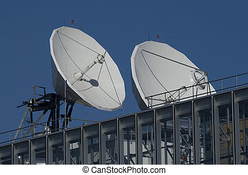 broadcast dishes - Two high-capacity satellite dishes used...