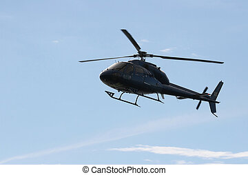 Blue Helicopter - Helecopter comming in to land at a open...