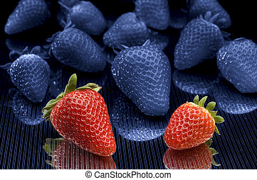 strawberry - two strawberryes in color standing out from...