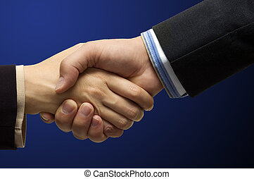 Hand shake - hand shake in front of a blue background -...