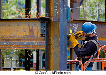 Welder - A construction worker welding an iron beam