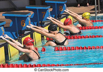 Backstroke start - Young girls on the starting block ready...