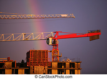 Construction crane and rainbow - The elevating crane of...