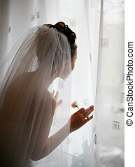 Expectation - The bride at a window expects the groom