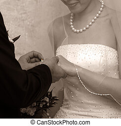 Putting on the ring - A wedding ceremony where bride and...