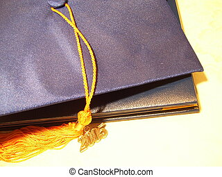 graduation cap on diploma case