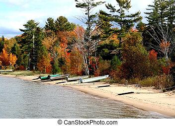 Lake Shore - boats on lake shore during autumn time